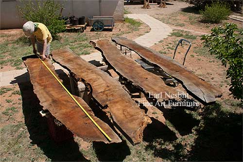 Earl measuring mesquite slabs for custom made live edge dining tables