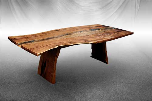 custom made natural edge mesquite slab dining table shows glass and curly maple in top
