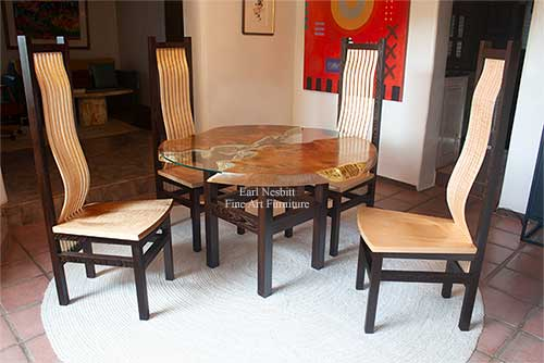 custom made round red mulberry live edge dining table with four custom chairs