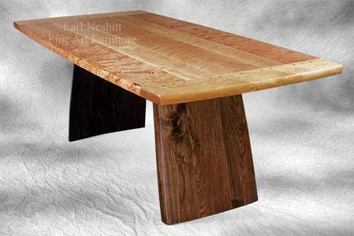 custom made cherry and walnut dining table with pegged breadboard ends