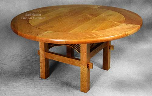 custom made round cherry and alder dining table shows curved slats in pegged through tenon base