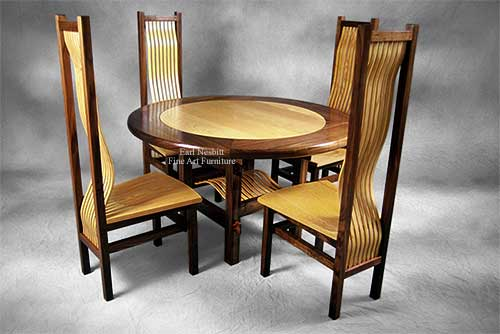 custom made round ash and walnut dining table set with four chairs showing slats in base